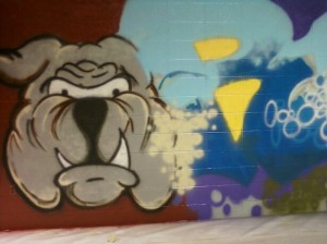 Spray paint on brick wall at The REAL School in Racine WI.